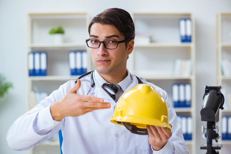 The safety doctor advising about wearing hard hat royalty free stock images