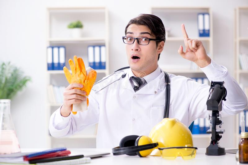 The safety doctor advising about wearing protective gloves royalty free stock image