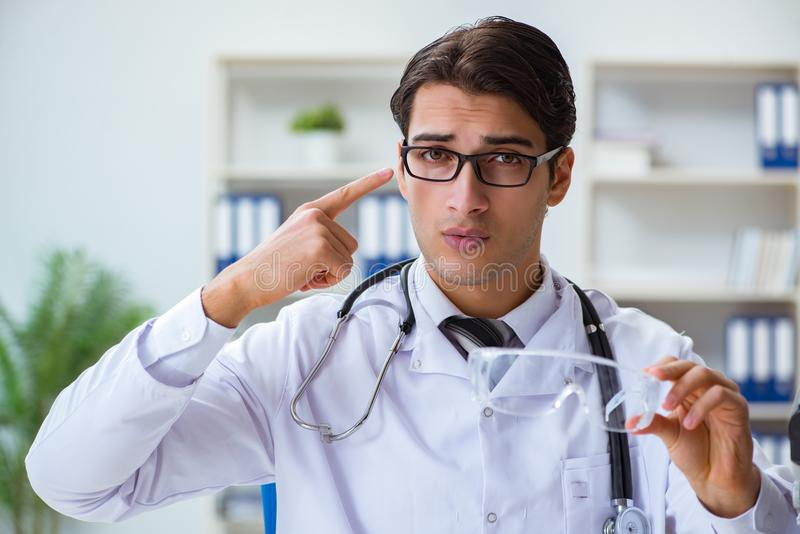 The safety doctor advising about wearing protective goggles stock photos