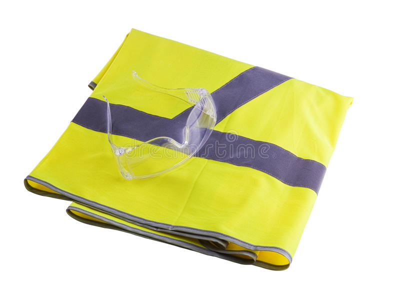 Safety equipment. Yellow vest and protection glasses isolated on white background royalty free stock image