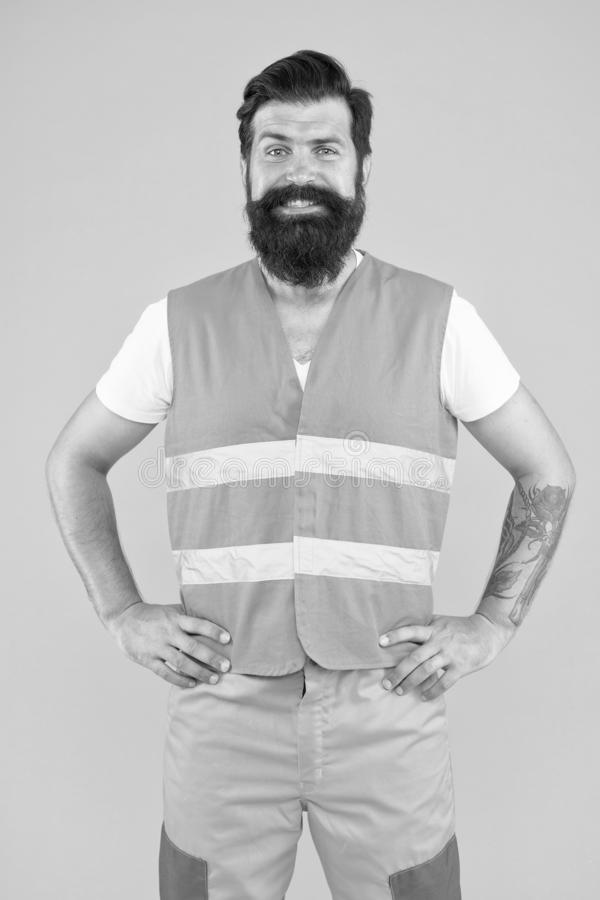 Safety equipment concept. Safety apparel for construction industry. Bearded brutal hipster safety engineer. High royalty free stock images