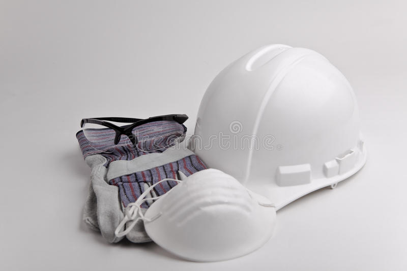 Safety equipment hard hat glasses glove and mask royalty free stock photos