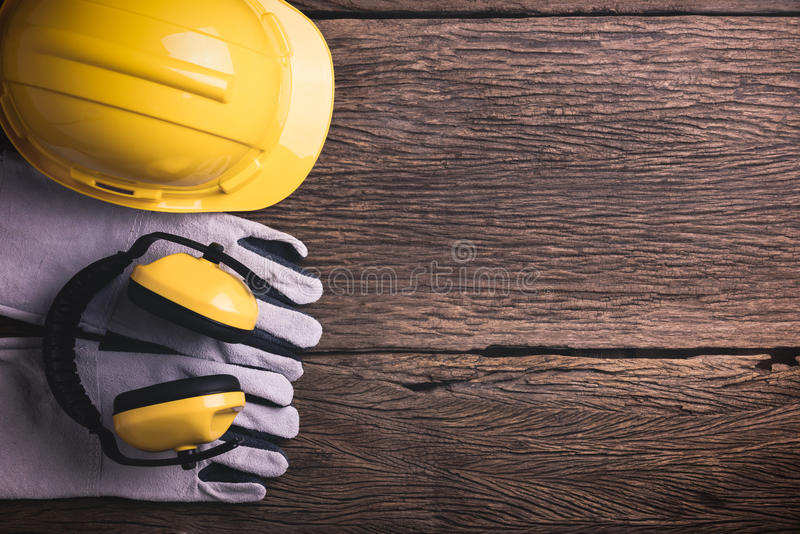 Download Safety Equipment And Tool Kit On Wooden Background Stock Photo - Image of protective, gear: 70254394