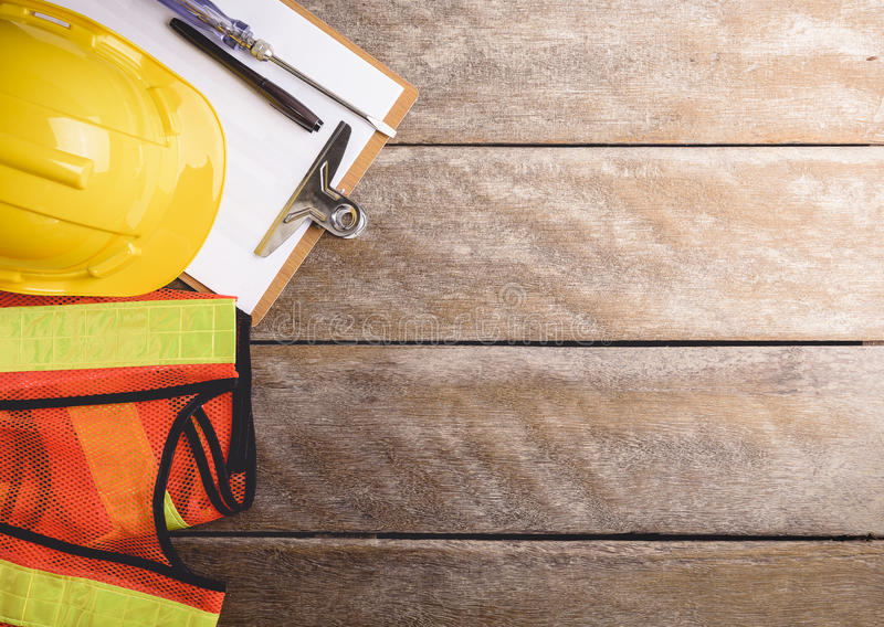 Download Safety Equipment And Tool Kit On Wooden Background Stock Photo - Image of clothing, work: 73211114