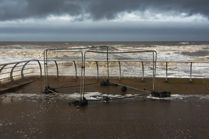 Safety fencing on the sea front as a storm approaches royalty free stock photo