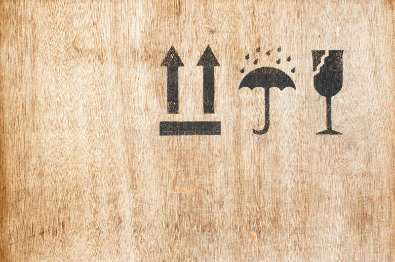 Safety fragile icon on wood board with space stock images