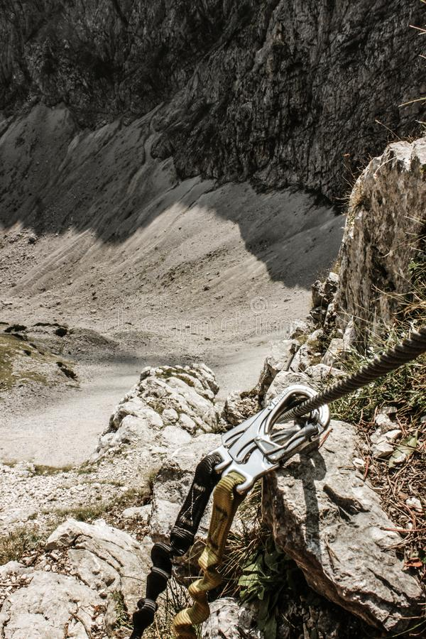 Climbing gear. Safety harness and clinch in high mountains. - Adrenaline royalty free stock image