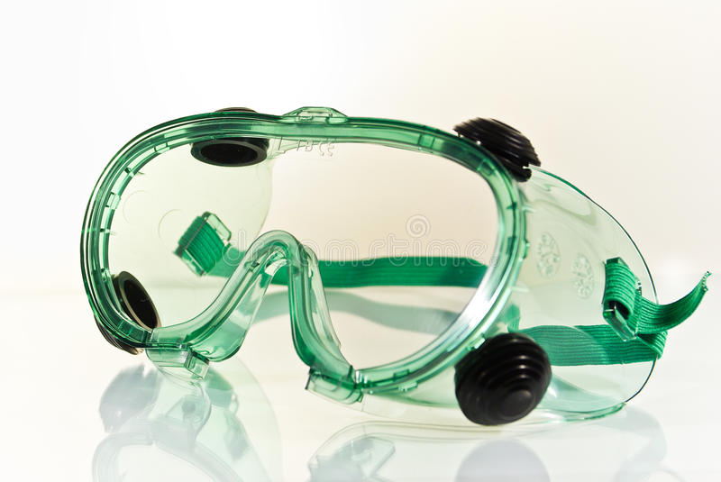Safety Glasses. Green safety glasses isolated on white background royalty free stock photography