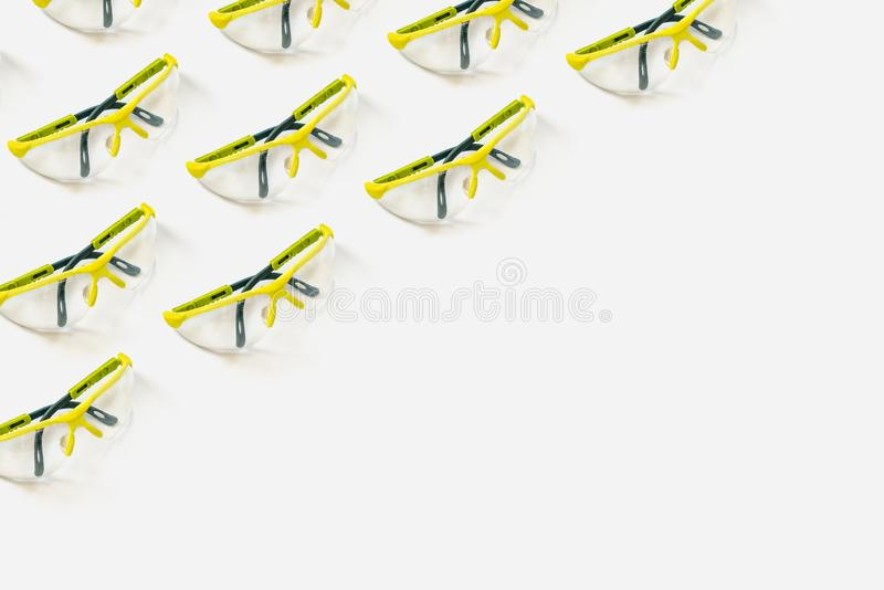 Safety glasses bright green on a white background. Pattern for your design. Safety glasses bright green on a light white background. Pattern for your design stock photography