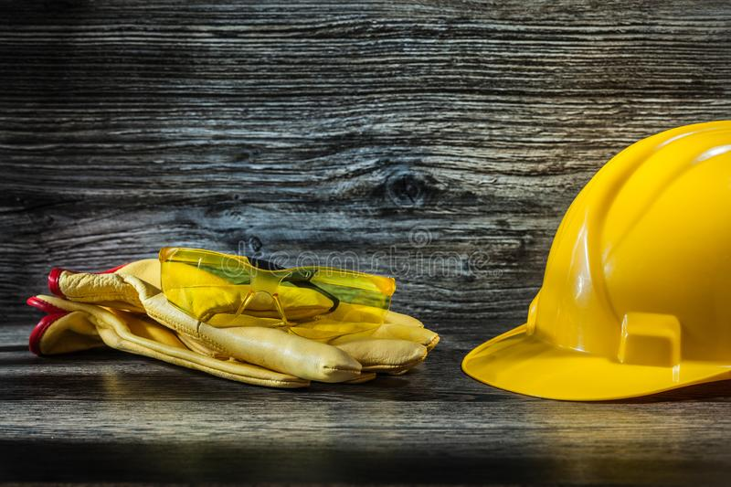 Safety glasses on working gloves and helmet royalty free stock photos