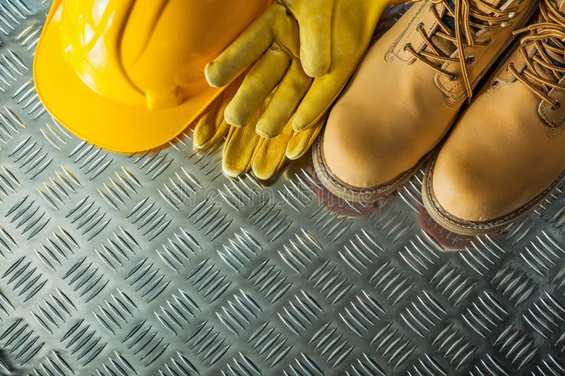 Safety gloves boots hard hat on corrugated metal plate stock photos