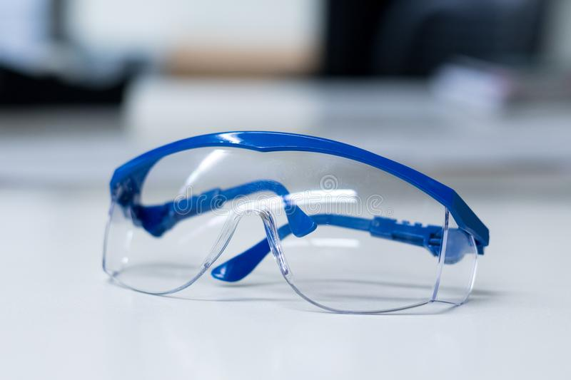 Safety goggles and blue gloves stock photos
