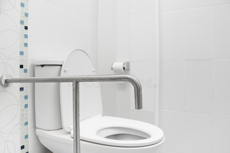 Safety and Grab Hand Rails for Toilets. Bathroom stock photography