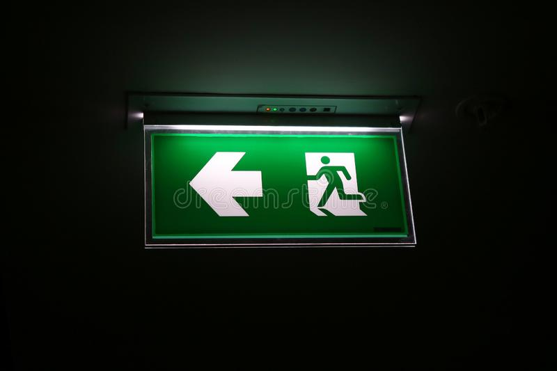 The safety green sign symbol for go to the fire exit royalty free stock photo