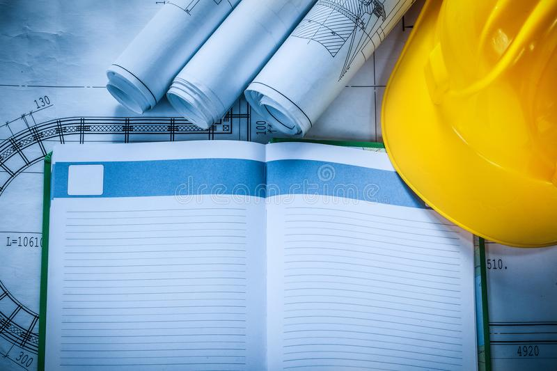 Safety hard hat construction plans notepad on blueprint stock photo download safety hard hat construction plans notepad on blueprint stock photo image of white malvernweather Image collections