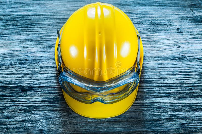 Safety hard hat goggles on vintage wooden board stock photos