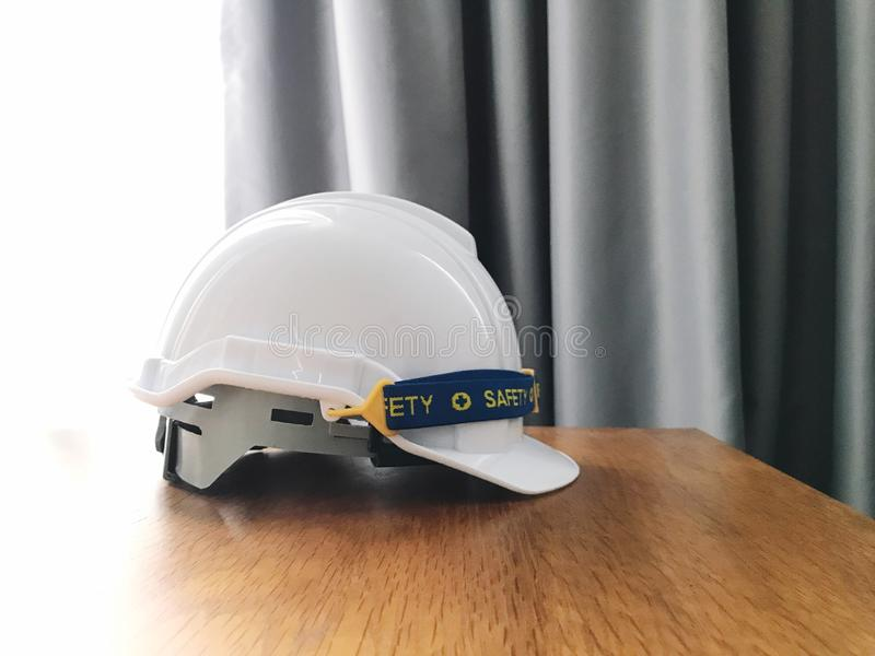 Safety hat. On table indoors stock photography