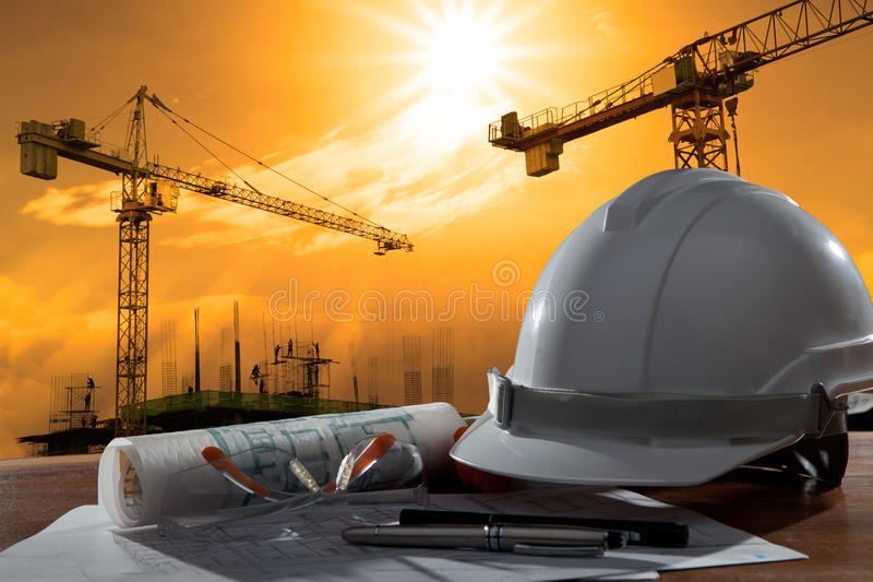 Download Safety Helmet And Architect Pland On Wood Table With Sunset Scen Stock Image - Image of construction, door: 33574911
