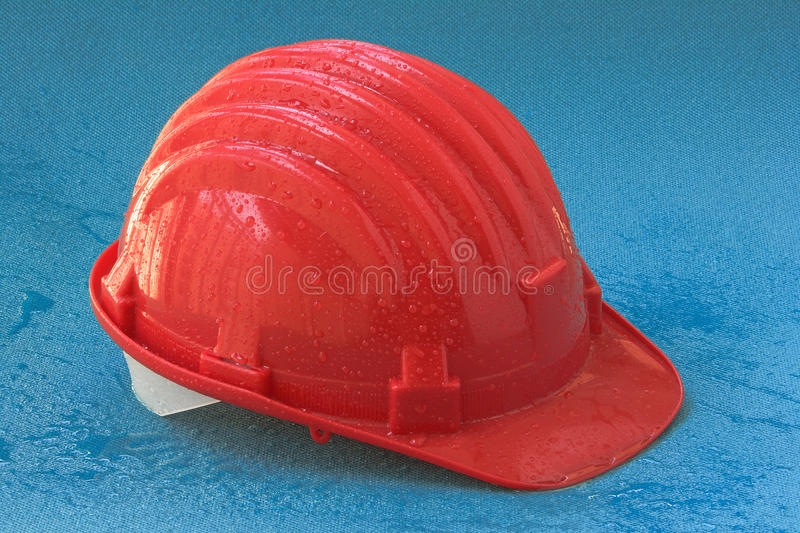 Helmet safety with drops on a blue royalty free stock photo