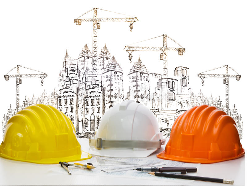 Safety helmet on engineer working table against sketching of building construction and high crane safety helmet on engineer royalty free stock photography