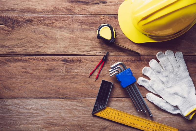 Safety helmet with safety equipment for work on wooden floor. royalty free stock image