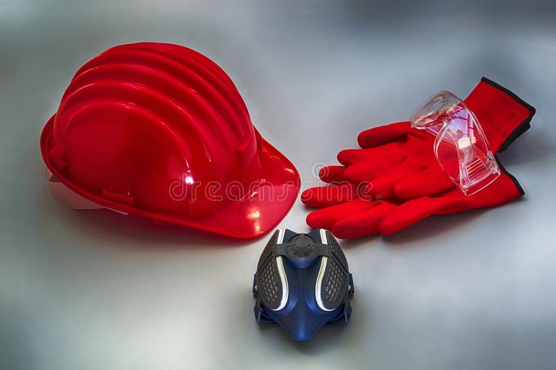 Safety helmet and others useful tools for self protection on a gray textured surface vector illustration