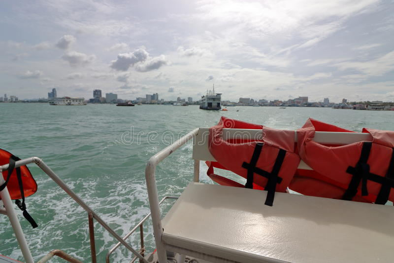 Safety life jacket on ferry boat sailing in sea. royalty free stock image