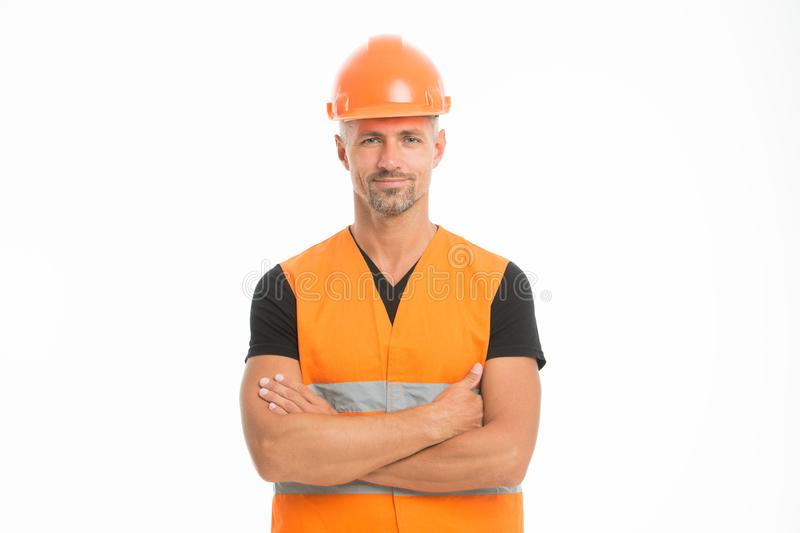 Safety is main point. Man protective hard hat and uniform white background. Worker builder confident looking camera stock photo