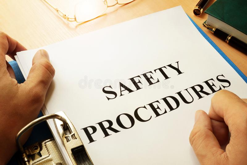 Safety procedures in a folder. Work Safety concept. Safety procedures in a blue folder. Work Safety concept stock image