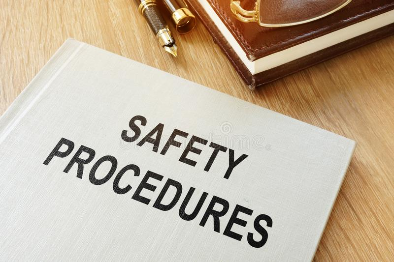 Safety procedures manual on a desk. royalty free stock image