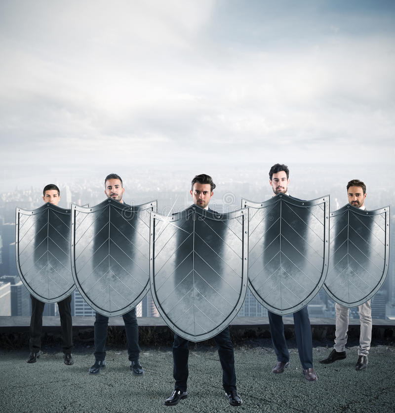 Safety and protection in business. Businessmen with shields. concept of protection and defense in the business world stock images