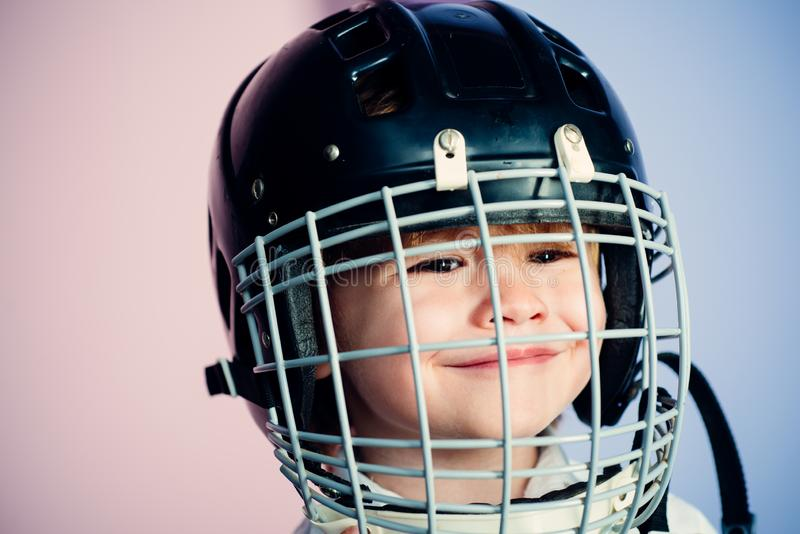 Safety and protection. Protective grid on face. Sport equipment. Hockey or rugby helmet. Sport childhood. Future sport. Star. Sport upbringing and career. Boy royalty free stock photo
