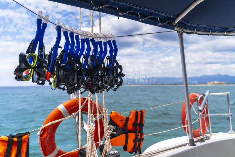 Safety ring and snorkeling goggles on the yacht near the beach Playa Ancon near Trinidad stock photo