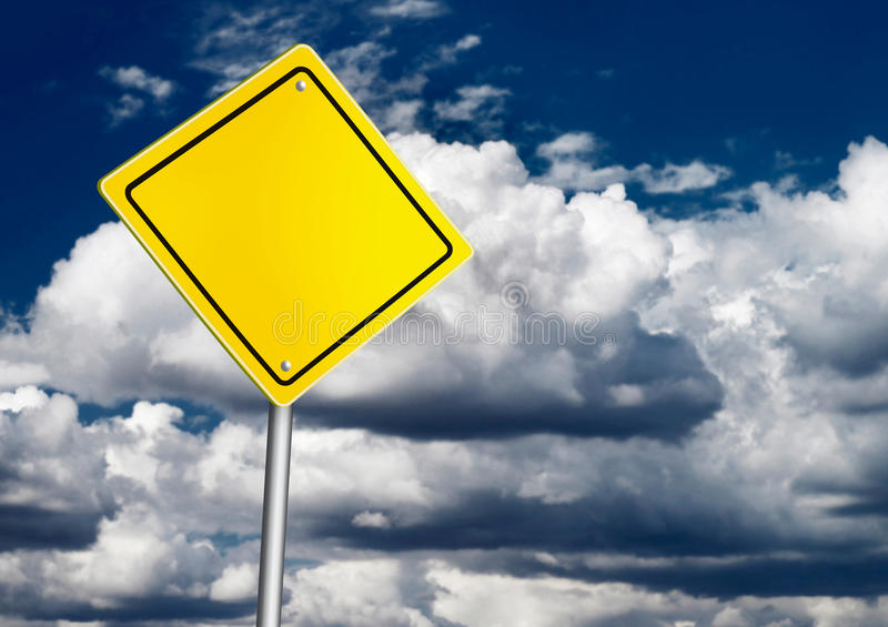 Safety road sign. Over dark sky royalty free stock photo