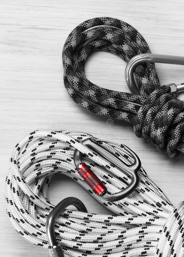 Safety ropes with carbines for conquering mountains against a light background stock photo