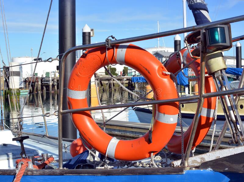 Safety at Sea - Orange Life Buoys on a Yacht Deck royalty free stock photos