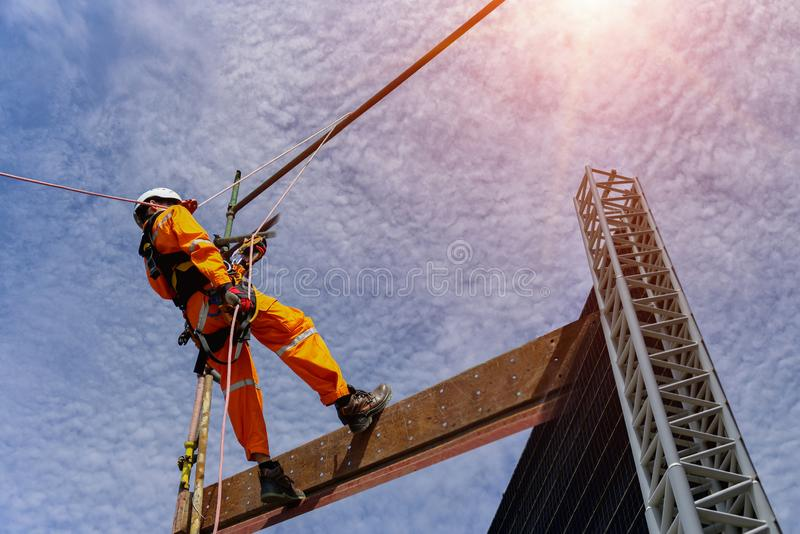 Safety sprinkling worker on high wear dresses wear equipment protective safety concept. Safety sprinkling worker on high wear dresses and safety man with stock photography