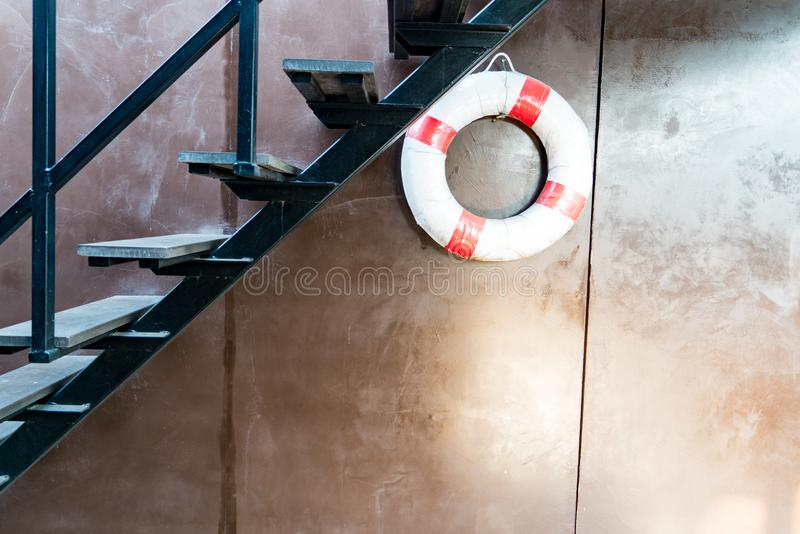 Safety torus hanging on the brown wall stock photos