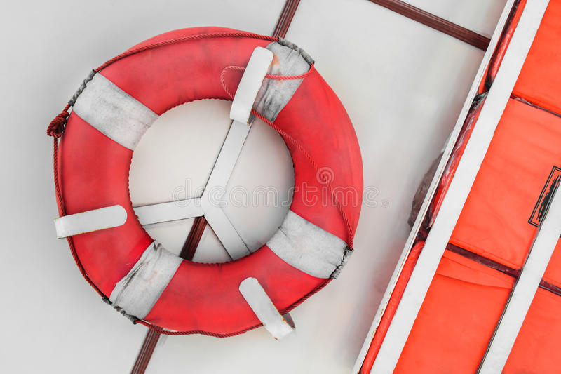 Safety torus and kick board for saving life. On ferryboat stock image