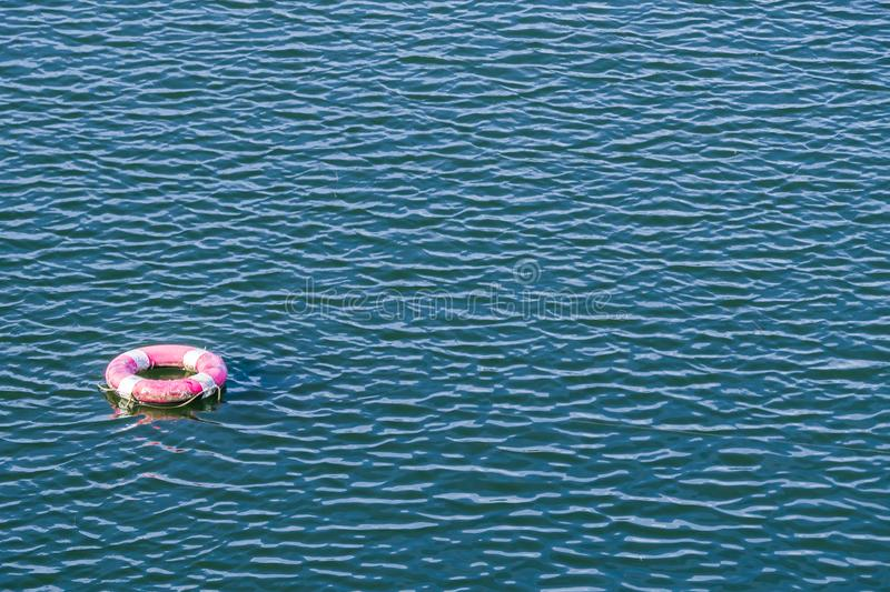 Safety Torus in the water stock photo