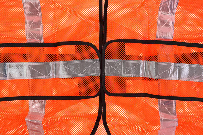 Safety Vest Front up Close. A close view of the front mid section of the safety vest royalty free stock image