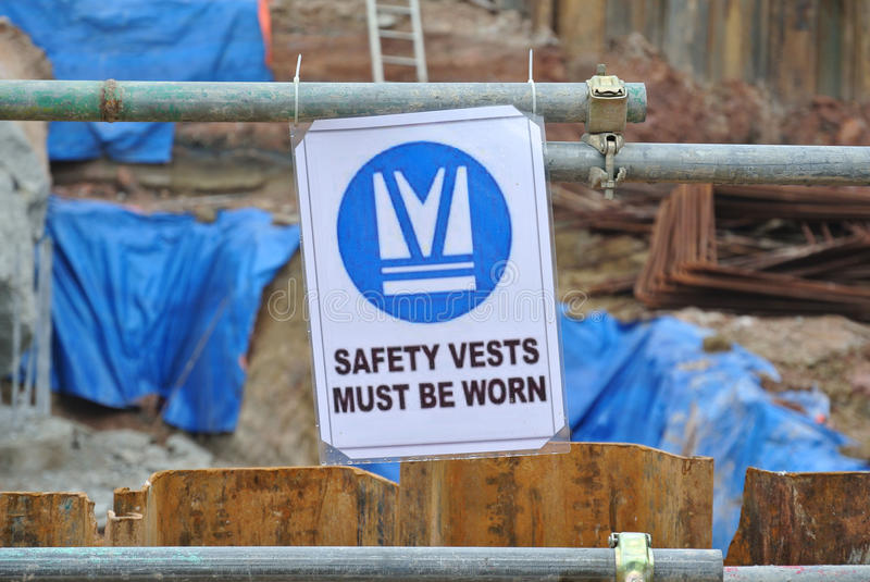 Safety vest sign at construction site. PERAK, MALAYSIA – SEPTEMBER 17, 2015: Safety vest sign at construction site. All workers entering this area must stock photography