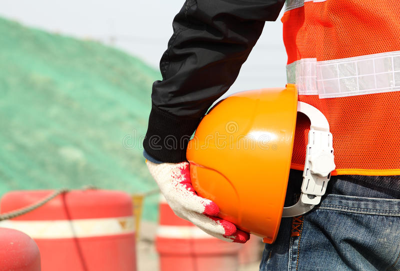 Safety work concept, construction worker holding helmet stock photo