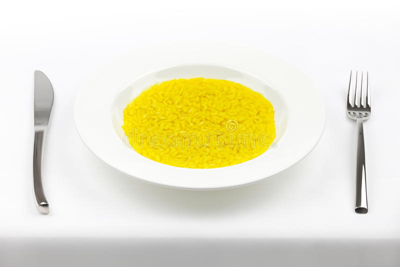Download Saffron Rice With Fork And Knife On Tablecloth Stock Photo - Image: 23814290