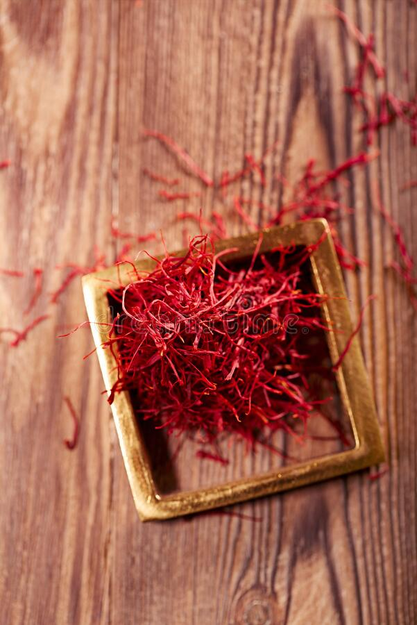 Saffron threads  pile with vintage wood backdrop stock photos