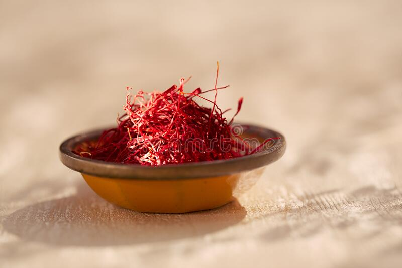 Saffron threads  in vintage dishes royalty free stock photography