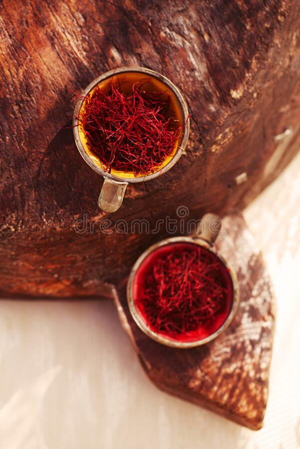 Saffron threads  in vintage dishes stock image