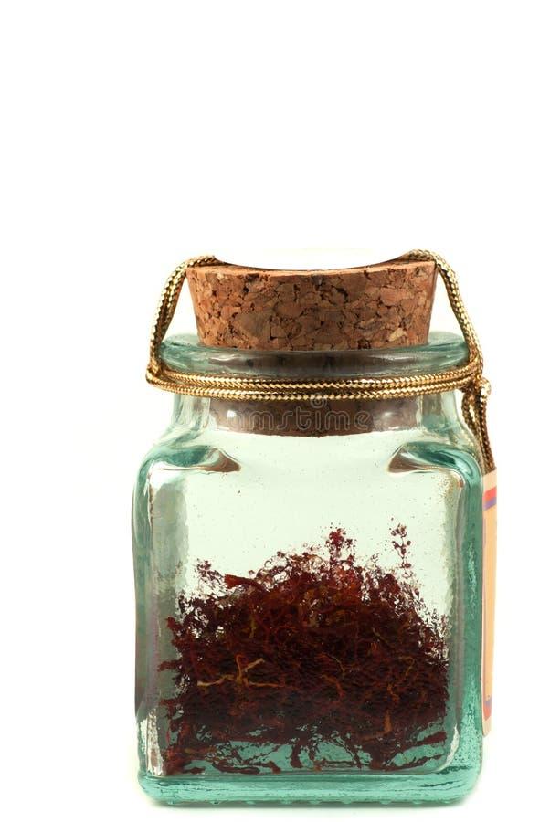 Safron em um frasco de vidro fotografia de stock