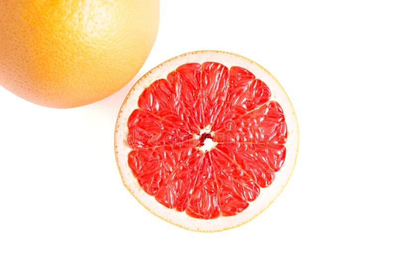 Saftig grapefrukt på vit bakgrund royaltyfri bild