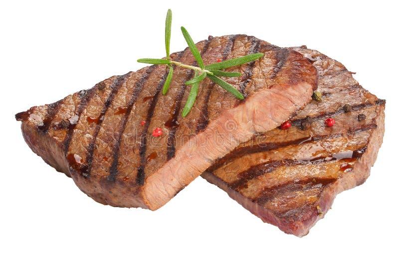 Saftiga nötköttbiffar som isoleras på vit royaltyfri fotografi